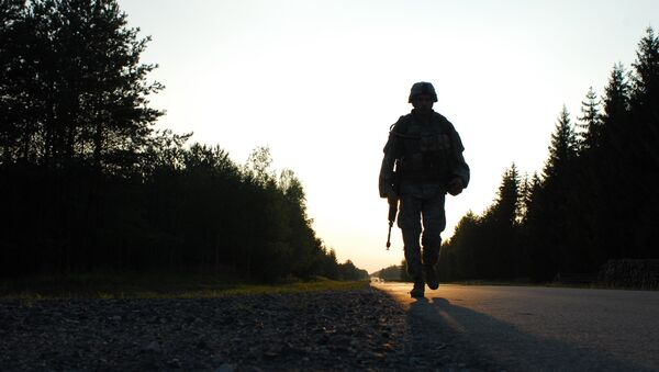 U.S. Army Cpl. Mihai Mocanu of Bravo Company, 2nd Battalion, 6th Infantry Regiment, performs a ruck march during the United States Army Europe Soldier and NCO of the Year Competition Aug. 15, 2007, at the Grafenwoehr Training Area in Germany. - Sputnik International