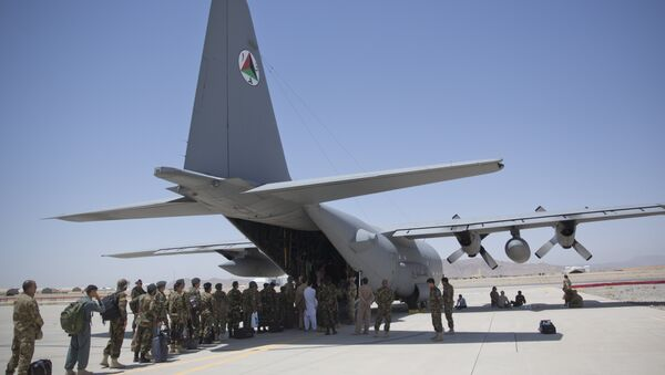 In this Tuesday, Aug. 18, 2015 photo, Afghan National Army soldiers line up to get into a C-130 Hercules, at Kandahar Air Base, in Kandahar, Afghanistan. - Sputnik International