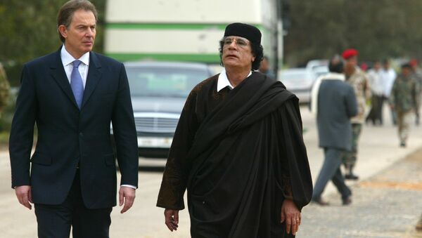 Libyan leader Col. Moammar Gadhafi, at right, with Britain's Prime Minister Tony Blair as they meet outside Tripoli, in Libya, Thursday, March, 25, 2004. - Sputnik International