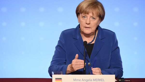 German Chancellor Angela Merkel addresses a joint press conference with the French president following a peace summit on Ukraine at the Elysee Palace in Paris, on October 2, 2015. - Sputnik International