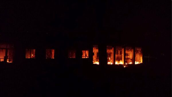 The Doctors Without Borders trauma center is seen in flames after explosions near their hospital, in the northern Afghan city of Kunduz - Sputnik International