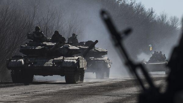 File photo of Ukrainian troops ride on tanks near Artemivsk, eastern Ukraine, Tuesday, Feb. 24, 2015 - Sputnik International