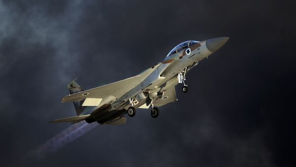 An Israeli F-15 E fighter jet takes off during an air show as part of the graduation ceremony of Israeli pilots at the Hatzerim air force base in the southern Negev desert, near the city of Beersheva, on June 25, 2015 - Sputnik International