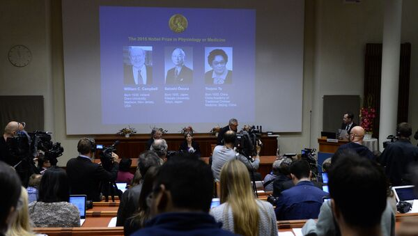 The portraits of the winners of the Nobel Medicine Prize 2015 (L-R) Irish-born William Campbell, Satoshi Omura of Japan and China's Youyou Tu are displayed on a screen during a press conference of the Nobel Committee to announce the winners of the 2015 Nobel Medicine Prize on October 5, 2015 at the Karolinska Institutet in Stockholm, Sweden - Sputnik International