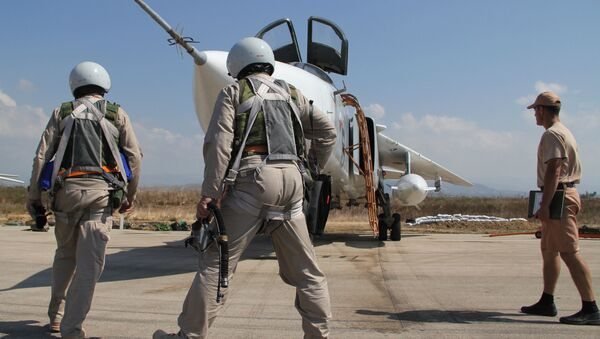 Russian pilots near a Su-24 aircraft before a mission, at the Khmeimim airbase in Syria - Sputnik International