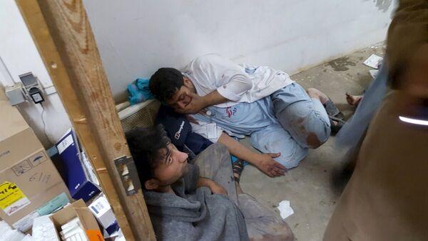 Afghan staff react inside a Medecins Sans Frontieres (MSF) hospital after an air strike in the city of Kunduz, Afghanistan in this October 3, 2015 - Sputnik International