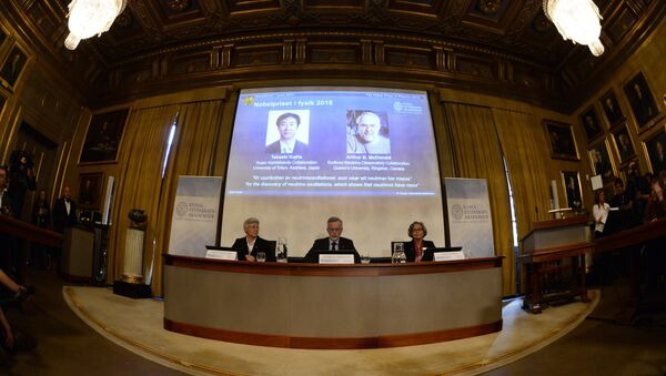 Anne L'Huillier, member of the Nobel Committee for Physics, Goran K Hansson, Permanent Secretary of the Royal Swedish Academy of Sciences, and Olga Botner, member of the Nobel Committee for Physics, sit in front of a screen displaying the winners of the Nobel Prize in Physics 2015 Takaaki Kajita (L) and Arthur B McDonald during a press conference of the Nobel Committee to announce the winners of the 2015 Nobel Prize in Physics on October 6, 2015 at the Swedish Academy of Sciences in Stockholm, Sweden - Sputnik International