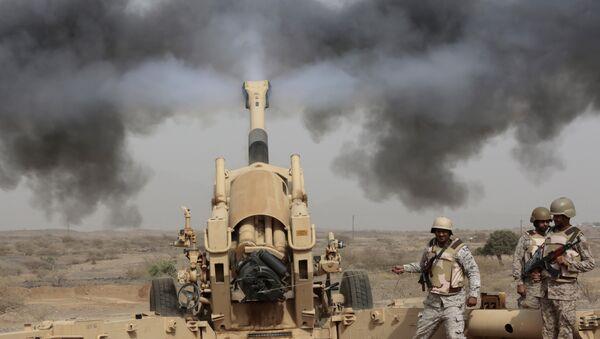 In this Monday, April 20, 2015, file photo, Saudi soldiers fire artillery toward three armed vehicles approaching the Saudi border with Yemen in Jazan, Saudi Arabia. - Sputnik International