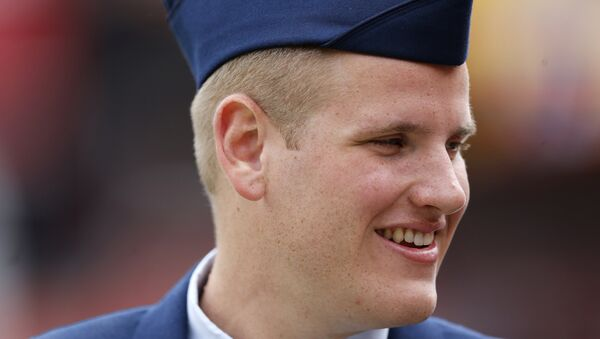 In this Sept. 20, 2015 file photo, US Air Force Airman 1st Class Spencer Stone walks along the sidelines before an NFL football game in Landover, Md. An Air Force spokesman said Thursday, Oct. 8, 2015, that Stone, who helped subdue an attacker on a Paris-bound train in August, is in stable condition after being stabbed in California. - Sputnik International