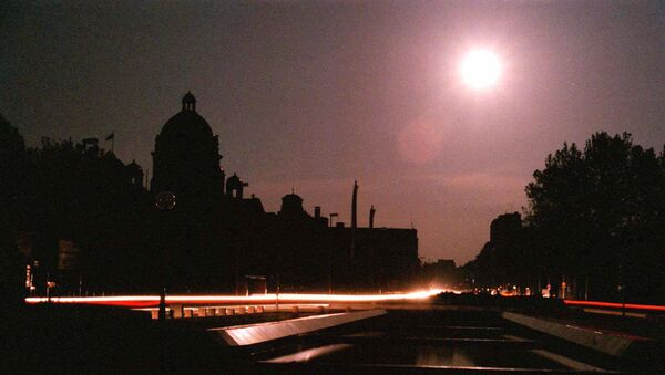 The dome of the Yugoslav Parliament building in downtown Belgrade is lit by moonlight after NATO jets hit power plants in Serbia during air raids early Monday May 3, 1999 plunging most of the country into darkness. Power was restored before dawn primarily to the hospitals, water supply services and bakeries - Sputnik International
