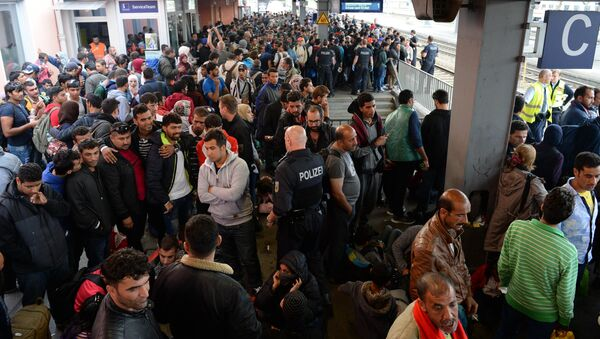 Refugees wait for a special train at the train station in Freilassing, near the Austrian-German border, southern Germany, on September 15, 2015 - Sputnik International