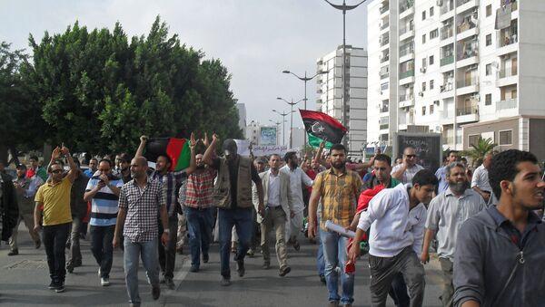 Demonstrators flood Martyrs' Square in Tripoli, 2013. - Sputnik International