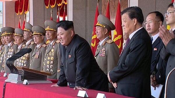 In this image made from video, North Korean leader Kim Jong Un, center, along with Liu Yunshan, China's Communist Party's No. 5 leader, third right, watches parade during the ceremony to mark the 70th anniversary of the country's ruling party in Pyongyang, Saturday, Oct. 10, 2015 - Sputnik International