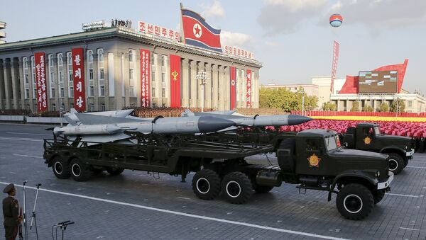Missiles are taken on trucks past a stand with North Korean leader Kim Jong Un during the parade celebrating the 70th anniversary of the founding of the ruling Workers' Party of Korea, in Pyongyang October 10, 2015 - Sputnik International