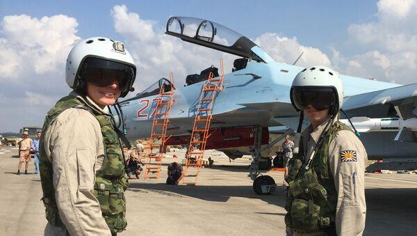 Russian pilots prepared to board the SU-30 attack plane to take off from the Hmeimim aerodrome in Syria. - Sputnik International