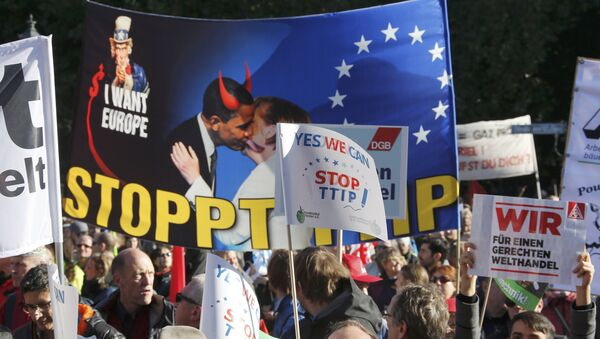 Consumer rights activists take part in a march to protest against the Transatlantic Trade and Investment Partnership (TTIP), mass husbandry and genetic engineering, in Berlin, Germany - Sputnik International