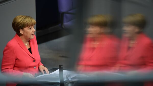 German Chancellor Angela Merkel addresses the Bundestag, the lower house of parliament in Berlin on September 24, 2015. Merkel said that a European Union deal to relocate 120,000 refugees was far from what was necessary to resolve the biggest migrant crisis facing the region since World War II. - Sputnik International