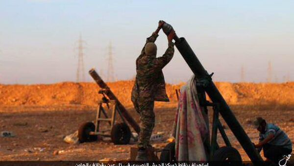 In this image posted on Thursday, Oct. 8, 2015, by the Rased News Network, a Facebook page affiliated with Islamic State, shows Islamic State militants preparing to fire a mortar to shell towards Syrian government forces positions at Tal Arn in Aleppo province, Syria - Sputnik International