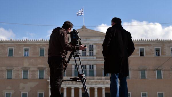Foreign media film the greek parliament in Athens on January 26, 2015 - Sputnik International