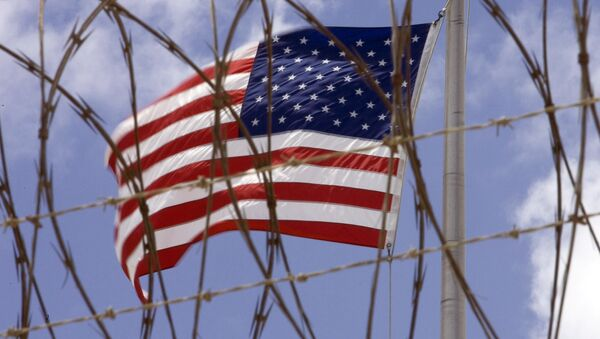A US flag flies in this April 24 2007 file photo at Camp V inside Camp Delta at the US Naval Station in Guantanamo Bay, Cuba - Sputnik International
