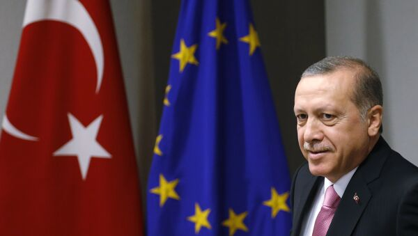 Turkish President Recep Tayyip Erdogan waits for the arrival of European Council President Donald Tusk prior to a meeting at the EU Council building in Brussels on Monday, Oct. 5, 2015. - Sputnik International