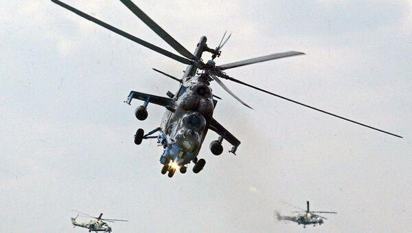 File Photo: Mi-24 helicopter gunships of Berkuty (Golden Eagles) Russian aerobatic team perform during the Flying Legend. - Sputnik International