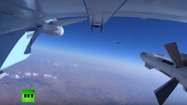 The Russian Defense Ministry released footage on Wednesday of bombs being dropped on targets in Syria. - Sputnik International