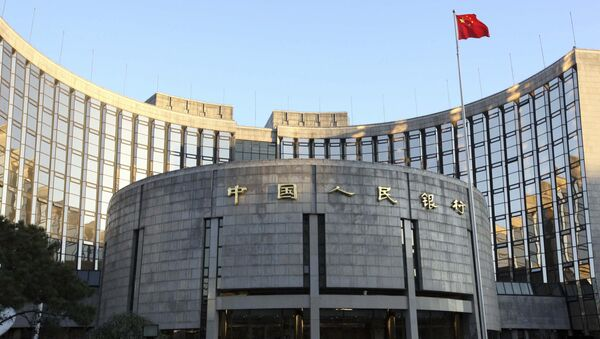 In this Nov. 27, 2008, file photo released by China's Xinhua News Agency, a Chinese flag flutters in front of the headquarters of the People's Bank of China (PBOC) in Beijing - Sputnik International