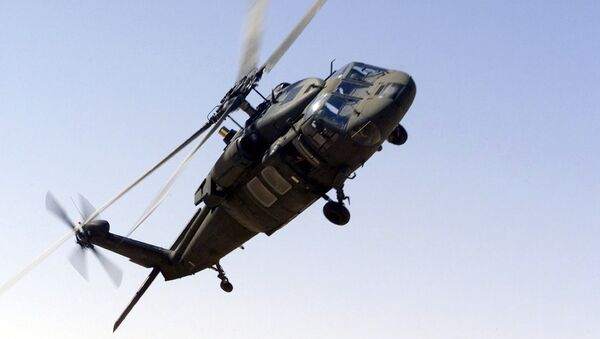 A picture taken 30 October 2000 shows an UH-60 Blackhawk helicopter flying near the Prince Sultan Air Base, Saudi Arabia. - Sputnik International