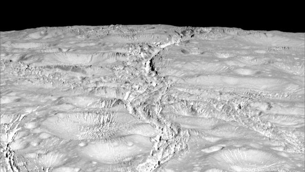 NASA's Cassini spacecraft zoomed by Saturn's icy moon Enceladus on Oct. 14, 2015, capturing this stunning image of the moon's north pole. - Sputnik International
