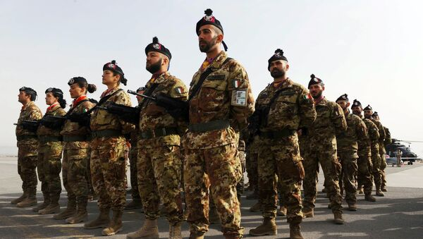 Italian soldiers stand to attention during a change of command ceremony at an Italian military camp near Herat airport - Sputnik International