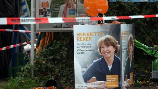 Election posters of independent candidate for the mayor of Cologne Henriette Reker stand behind a police barrier in Cologne, Germany, Saturday, Oct. 17, 2015. - Sputnik International