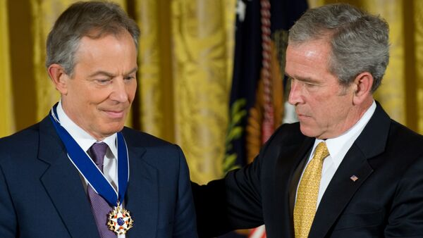 US President George W. Bush presents the Presidential Medal of Freedom to former British Prime Minister Tony Blair (L) in the East Room of the White House in Washington. (File) - Sputnik International