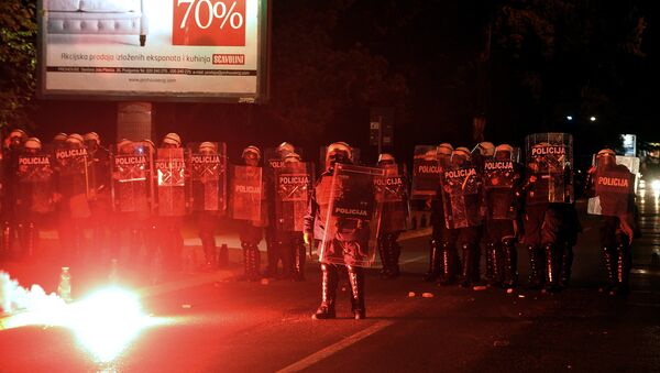 Demonstrators throwing torches at Montenegrin police officers during anti-government protest in Podgorica, Montenegro, Sunday, Oct. 18, 2015. - Sputnik International