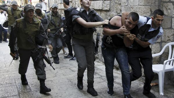 Israeli policemen arrest a Palestinian man during confrontations in the Old City in Jerusalem, Wednesday, Sept. 30, 2015. Tensions over the hilltop revered by Jews as the Temple Mount and by Muslims as the Noble Sanctuary, continued Wednesday as Jews mark the Sukkot holiday - Sputnik International