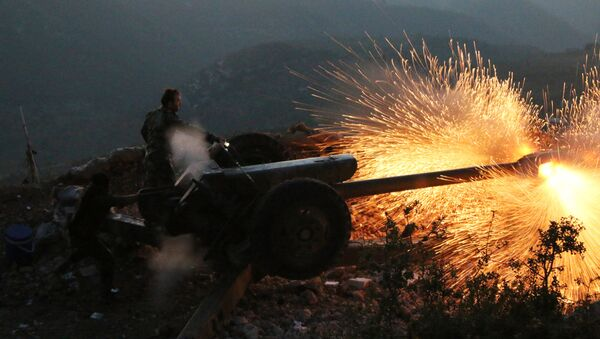 In this photo taken on Saturday, Oct. 10, 2015, Syrian army personnel fire a cannon in Latakia province, about 12 from the border with Turkey in Syria - Sputnik International