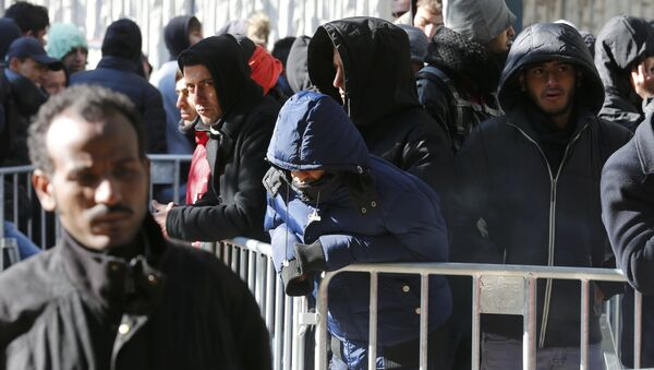 Migrants queue in the compound outside the Berlin Office of Health and Social Affairs (LAGESO) as they wait to register in Berlin, Germany, October 12, 2015 - Sputnik International