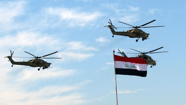 Iraqi Army helicopters fly in formation during the Army Day celebrations in Baghdad, Iraq, Tuesday, Jan. 6, 2015 - Sputnik International