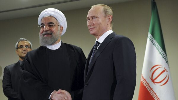 Russia's President Vladimir Putin (R) meets with Iran's President Hassan Rouhani on the sidelines of the United Nations General Assembly in New York, September 28, 2015 - Sputnik International