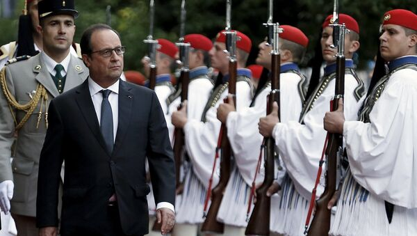 French President Francois Hollande inspects a guard of honour with his Greek counterpart Prokopis Pavlopoulos (not pictured) at a welcome ceremony in Athens, Greece, October 22, 2015. Hollande is paying a two-day official visit to Greece. - Sputnik International