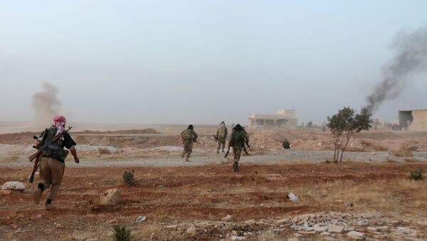 A picture taken on October 17, 2015 shows smoke billowing as Syrian opposition fighters run in the Mount Azzan area, 24 kms from the northern Syrian city of Aleppo, during reported fighting against forces loyal to Syrian President Bashar al-Assad - Sputnik International