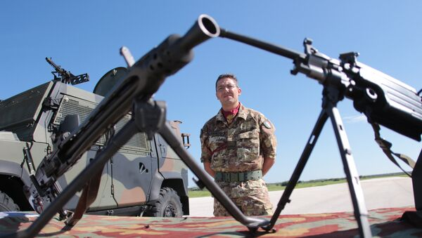 A soldier attends the opening ceremony of NATO's large scale exercise Trident Juncture 2015 at the Italian Air Force Base in Trapani, Sicily. - Sputnik International
