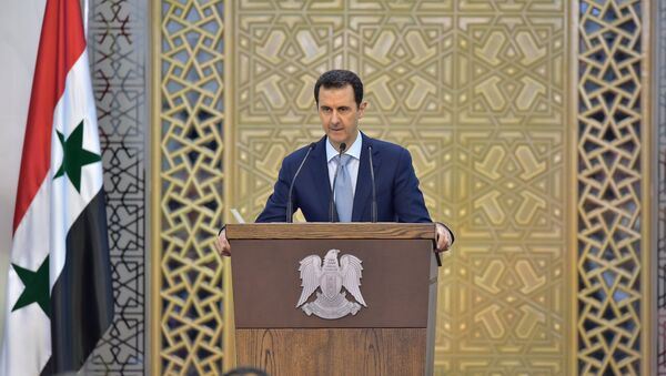 In this Sunday, July 26, 2015, file photo released by the Syrian official news agency SANA, Syrian President Bashar Assad delivers a speech in Damascus, Syria. - Sputnik International