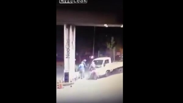 Truck Driver Turns Things Around Against Bandits at Service Station Read more at http://www.liveleak.com/view?i=865_1445921728#ExpmJOwpetuxfYYW.99 - Sputnik International