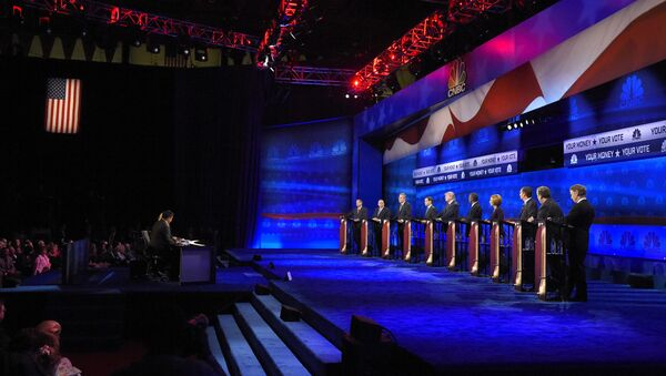 Republican presidential candidates, from left, John Kasich, Mike Huckabee, Jeb Bush, Marco Rubio, Donald Trump, Ben Carson, Carly Fiorina, Ted Cruz, Chris Christie, and Rand Paul take the stage during the CNBC Republican presidential debate at the University of Colorado, Wednesday, Oct. 28, 2015, in Boulder, Colo - Sputnik International