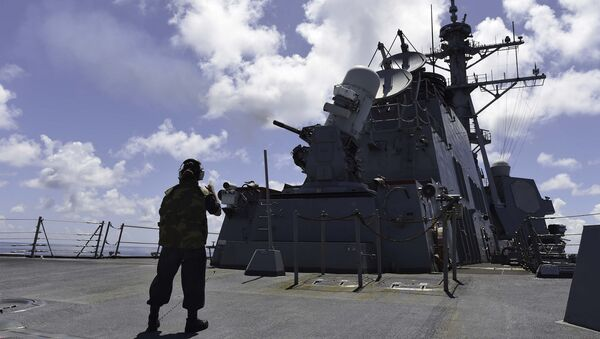 Gunner's Mate Seaman Brenda Algado from Dallas, Texas observes a live-fire exercise with a close-in weapon system (CWIS) aboard the Arleigh Burke-class guided-missile destroyer USS Lassen (DDG 82) - Sputnik International