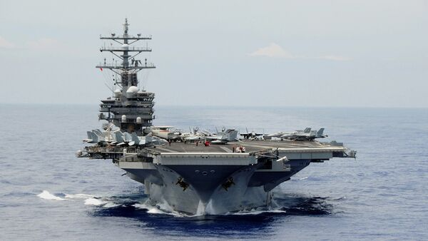 The aircraft carrier USS Ronald Reagan (CVN 76) is participating in Rim of the Pacific (RIMPAC) Exercise 2014 - Sputnik International