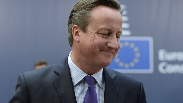 British Prime Minister David Cameron arrives to take part in a European Union (EU) summit dominated by the migration crisis at the European Council in Brussels, on October 15, 2015 - Sputnik International