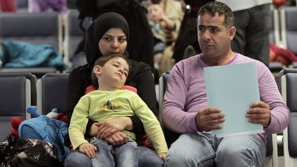 Syrian refugees wait to board a flight to Germany for temporary relocation, at Rafik Hariri International Airport in Beirut, Lebanon, Wednesday, Sept. 11, 2013. - Sputnik International