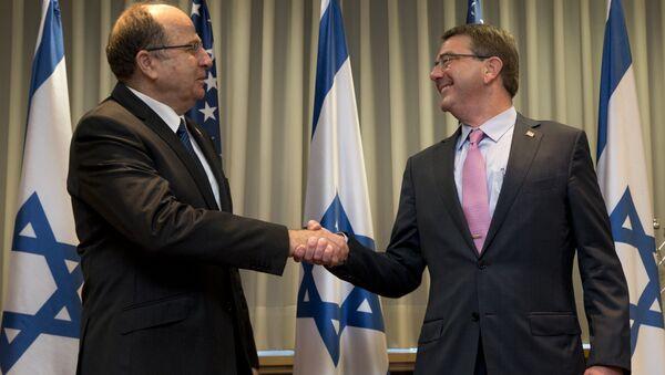 US Defense Secretary Ash Carter, right, and Israeli Defense Minister Moshe Ya'alon shake hands at Israel's Defense Force headquarters in Tel Aviv, Monday, July 20, 2015. - Sputnik International